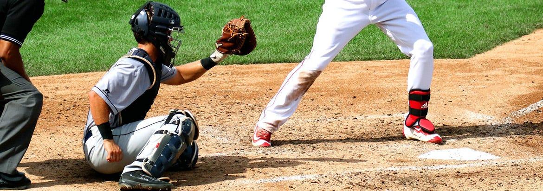 baseball catcher framing a pitch